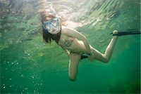 preteen swim - Girl snorkeling in tropical waters Stock Photo - Premium Royalty-Freenull, Code: 649-06164858