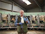 Farmer holding milk in milking parlor Stock Photo - Premium Royalty-Free, Artist: Ascent Xmedia, Code: 649-06164958