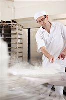 Chef baking in kitchen Stock Photo - Premium Royalty-Freenull, Code: 649-06165010