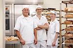 Chefs smiling together in kitchen Stock Photo - Premium Royalty-Free, Artist: Blend Images, Code: 649-06165030