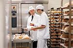 Health inspector with chef in kitchen Stock Photo - Premium Royalty-Free, Artist: Mitch Tobias, Code: 649-06165038