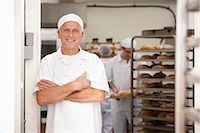 Chef smiling in kitchen Stock Photo - Premium Royalty-Freenull, Code: 649-06165040