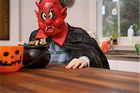 Boy wearing Halloween costume Stock Photo - Premium Royalty-Freenull, Code: 649-06165210