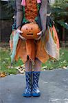 Girl in Halloween costume with pumpkin Stock Photo - Premium Royalty-Free, Artist: CulturaRM, Code: 649-06165223