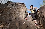 Climber scaling steep boulders Stock Photo - Premium Royalty-Free, Artist: Blend Images, Code: 649-06165285