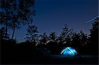 Glowing lights in tent at campsite Stock Photo - Premium Royalty-Freenull, Code: 649-06165308