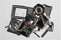 Pile of smashed camera parts Stock Photo - Premium Royalty-Freenull, Code: 649-06165313