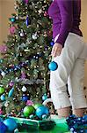 Woman decorating a Christmas tree Stock Photo - Premium Royalty-Free, Artist: Aflo Relax, Code: 6106-06165475