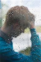 Man behind a glass Stock Photo - Premium Royalty-Freenull, Code: 6108-06165981