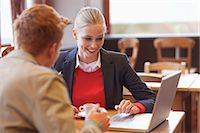partnership - Couple sitting in a restaurant working on a laptop Stock Photo - Premium Royalty-Freenull, Code: 6108-06166064