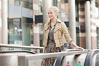 Businesswoman standing on escalator Stock Photo - Premium Royalty-Freenull, Code: 6108-06166099