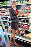 Woman shopping in a supermarket Stock Photo - Premium Royalty-Free, Artist: Mitch Tobias, Code: 6108-06166100