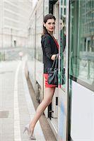 Woman boarding a tram Stock Photo - Premium Royalty-Freenull, Code: 6108-06166103