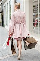Woman carrying shopping bags Stock Photo - Premium Royalty-Freenull, Code: 6108-06166106