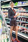 Woman shopping in a supermarket Stock Photo - Premium Royalty-Free, Artist: CulturaRM, Code: 6108-06166109