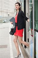 Woman exiting from a bus Stock Photo - Premium Royalty-Freenull, Code: 6108-06166132