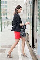 Woman boarding a bus Stock Photo - Premium Royalty-Freenull, Code: 6108-06166149