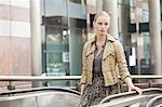 Businesswoman standing on escalator Stock Photo - Premium Royalty-Free, Artist: Blend Images, Code: 6108-06166152
