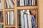 Woman choosing books from a bookshelf Stock Photo - Premium Royalty-Free, Artist: CulturaRM, Code: 6108-06166199