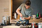 Man preparing food in the kitchen Stock Photo - Premium Royalty-Freenull, Code: 6108-06166265