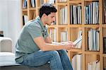 Man reading an electronic book Stock Photo - Premium Royalty-Free, Artist: Blend Images, Code: 6108-06166287