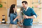 Couple drinking wine in the kitchen Stock Photo - Premium Royalty-Free, Artist: Cultura RM, Code: 6108-06166376