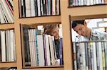 Couple choosing books from a bookshelf Stock Photo - Premium Royalty-Free, Artist: CulturaRM, Code: 6108-06166427
