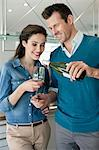 Couple drinking wine in the kitchen Stock Photo - Premium Royalty-Free, Artist: Cultura RM, Code: 6108-06166446