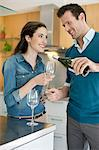 Couple drinking wine in the kitchen Stock Photo - Premium Royalty-Free, Artist: Dana Hursey, Code: 6108-06166455