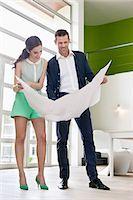 Couple reading a blueprint Stock Photo - Premium Royalty-Freenull, Code: 6108-06166491