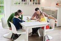 Couple teaching their children at home Stock Photo - Premium Royalty-Freenull, Code: 6108-06166588