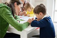 Couple teaching their children at home Stock Photo - Premium Royalty-Freenull, Code: 6108-06166608