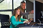 Girl using a computer with her father at home Stock Photo - Premium Royalty-Free, Artist: Cultura RM, Code: 6108-06166610