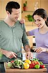 Couple cooking in the kitchen Stock Photo - Premium Royalty-Freenull, Code: 6108-06166640