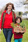 Mother and son with a crate of homegrown vegetables Stock Photo - Premium Royalty-Free, Artist: Glowimages, Code: 6108-06166643