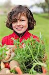 Happy boy with a crate of homegrown vegetables Stock Photo - Premium Royalty-Free, Artist: Glowimages, Code: 6108-06166662