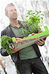 Man holding a tray of raw vegetables Stock Photo - Premium Royalty-Free, Artist: Angus Fergusson, Code: 6108-06166691