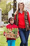Mother and son with a crate of homegrown vegetables Stock Photo - Premium Royalty-Freenull, Code: 6108-06166713