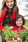 Mother and son with a crate of homegrown vegetables Stock Photo - Premium Royalty-Free, Artist: Glowimages, Code: 6108-06166722