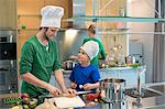 Family cooking in the kitchen Stock Photo - Premium Royalty-Free, Artist: Glowimages, Code: 6108-06166754