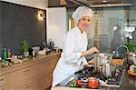 Woman cooking food in the kitchen Stock Photo - Premium Royalty-Free, Artist: Cultura RM, Code: 6108-06166757