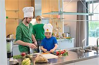 Family cooking in the kitchen Stock Photo - Premium Royalty-Freenull, Code: 6108-06166769
