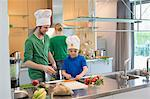 Family cooking in the kitchen Stock Photo - Premium Royalty-Free, Artist: Glowimages, Code: 6108-06166769