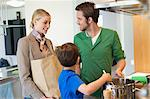 Man and son cooking food for mother returned from shopping Stock Photo - Premium Royalty-Freenull, Code: 6108-06166779