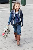 Portrait of a schoolgirl carrying schoolbag Stock Photo - Premium Royalty-Freenull, Code: 6108-06166792