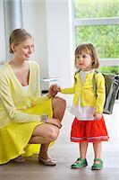 Little girl getting ready for school Stock Photo - Premium Royalty-Freenull, Code: 6108-06166814
