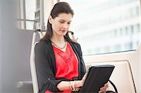 Woman traveling in a bus using a digital tablet Stock Photo - Premium Royalty-Freenull, Code: 6108-06166986