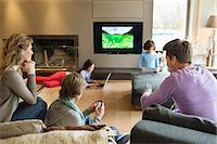 five people - Family using electronic gadgets in a living room Stock Photo - Premium Royalty-Freenull, Code: 6108-06166994