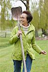 Woman walking with a spade in a park Stock Photo - Premium Royalty-Free, Artist: Garreau Designs, Code: 6108-06167087