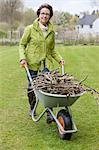 Woman pushing a wheelbarrow full of branches Stock Photo - Premium Royalty-Free, Artist: Shannon Ross, Code: 6108-06167096